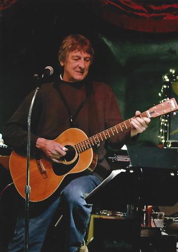 Tom Miller plays at Laxalt Plaza